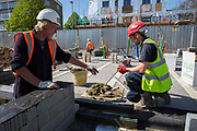 Builders laying the foundations of a new house on a home building construction site in Norwich. Norfolk. United Kingdom. (photo by Andrew Aitchison / In pictures via Getty Images)(photo by Andrew Aitchison / In pictures via Getty Images)