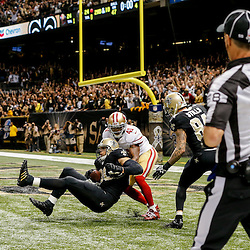 Nov 9, 2014; New Orleans, LA, USA; New Orleans Saints tight end Jimmy Graham (80) catches a ball in the endzone past San Francisco 49ers strong safety Antoine Bethea (41) but is flagged for offensive pass interference negating a touchdown on the final play of the fourth quarter of a game at Mercedes-Benz Superdome. The 49ers defeated the Saints 27-24 in overtime. Mandatory Credit: Derick E. Hingle-USA TODAY Sports