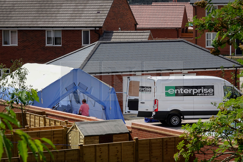 © Licensed to London News Pictures. 04/07/2018. Amesbury, UK.  A police tent has been erected at a property where a couple, named locally as Dawn Sturgess, 44, and her partner Charlie Rowley, 45, were taken ill on Saturday 30th June 2018. Police have confirmed that the couple have been in contact with Novichok nerve agent. Former Russian spy Sergei Skripal and his daughter Yulia were poisoned with Novichok nerve agent in nearby Salisbury in March 2018.Photo credit: Peter Macdiarmid/LNP