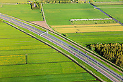 Nederland, Zuid-Holland, gemeente Giessenlanden, 09-05-2013; A27 door de landelijke Alblasserwaard.<br /> Motorway through country site.<br /> luchtfoto (toeslag op standard tarieven)<br /> aerial photo (additional fee required)<br /> copyright foto/photo Siebe Swart