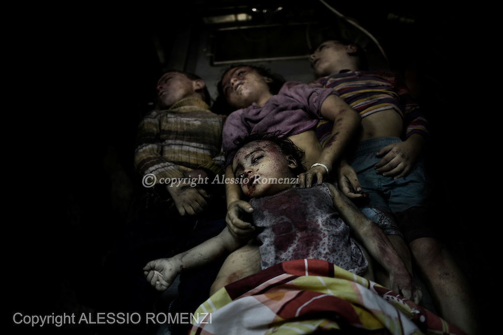 Gaza City: The bodies of four children from the al-Dallu family lay in a hospital after an Israeli missile struck a family home killing at least seven members of the same family in Gaza City. November 18, 2012. ALESSIO ROMENZI