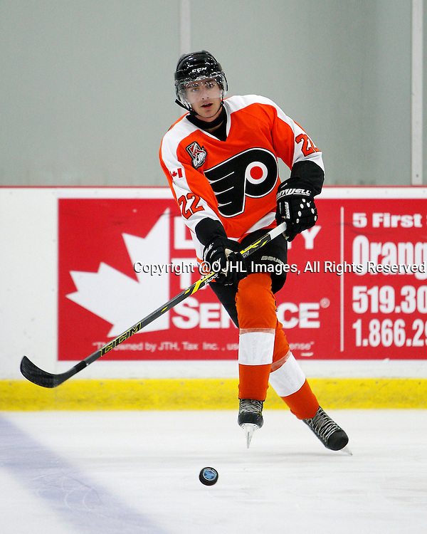 ORANGEVILLE, ON - Sep 5, 2015 : Ontario Junior Hockey League game action between Wellington and Orangeville, Zack Lyons #22 of the Orangeville Flyers passes the puck during warmup.<br /> (Photo by Brian Watts / OJHL Images)