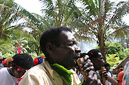 "Playing music through pipes as a procession starts at the beginning of ""school closing"" festivities, on Han Island, Carterets Atoll, Papua New Guinea, on Monday, Dec. 11, 2006."
