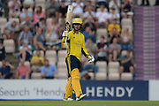 Colin Munro of Hampshire raises his bat on reaching his half century during the Vitality T20 Blast South Group match between Hampshire County Cricket Club and Middlesex County Cricket Club at the Ageas Bowl, Southampton, United Kingdom on 20 July 2018. Picture by Dave Vokes.