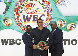 October 1, 2018 - Kiev, Ukraine - Former Boxing Champion EVANDER HOLYFIELD (L) and former Boxing Champion LENNOX LEWIS (R) put the belt of the honorary world champion by the WBC version on Ukrainian boxer VLADIMIR KLITSCHKO (C) during awarding at the opening of the 56th World Boxing Convention in Kiev, Ukraine, on 1 October 2018. The WBC 56th congress in which take part boxing legends Evander Holyfield,Lennox Lewis, Eric Morales and about 700 participants from 160 countries runs in Kiev from from September 30 to October 5. (Credit Image: © Serg Glovny/ZUMA Wire)