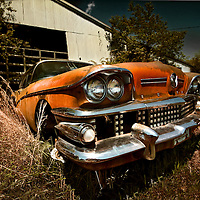 Starting in 1958 the design of American cars added a lot of chrome and extra dazzle for the pure sake of ornamentation.  You can see evidence of that in this Buick's grille - hundreds of chrome cubes surely designed to sparkle.  Only a few teeth appear to be knocked out on this car.