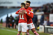 Jacob Brown of Barnsley FC and Conor Chaplin of Barnsley FC celebrating their team's second goal during the EFL Sky Bet Championship match between Barnsley and Queens Park Rangers at Oakwell, Barnsley, England on 14 December 2019.