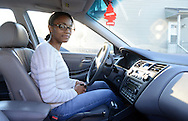 Nykeisha Johnson, of Warminster, Pennsylvania, a recent recipient of a set of wheels through the Bucks County Opportunity Council's Wheelz to Work program sits in the car Monday November 16, 2015 in Warminster, Pennsylvania.  (Photo by William Thomas Cain)