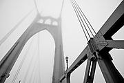 Dense fog envelopes the St. Johns Bridge in Portland, Oregon.