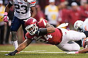 FAYETTEVILLE, AR - OCTOBER 31:  Kody Walker #24 of the Arkansas Razorbacks dives over the goal line for a touchdown during a game against the UT Martin Skyhawks at Razorback Stadium on October 31, 2015 in Fayetteville, Arkansas.  The Razorbacks defeated the Skyhawks 63-28.  (Photo by Wesley Hitt/Getty Images) *** Local Caption *** Kody Walker