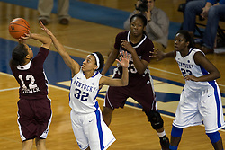 UK guard Kastine Evans, center, contests a shot by Mississippi State guard Candace Foster in the second half. The University of Kentucky Women hosted Mississippi State University Thursday, Jan. 17, 2013 at Memorial Coliseum in Lexington. Photo by Jonathan Palmer