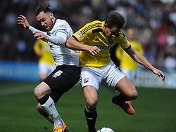 Richard Keogh Captain Derby County, battles with Brentfords James Tarkowski, Derby County v Brentford, Sy Bet Championship, IPro Stadium, Saturday 11th April 2015. Score 1-1,  (Bent 92) (Pritchard 28)<br /> Att 30,050