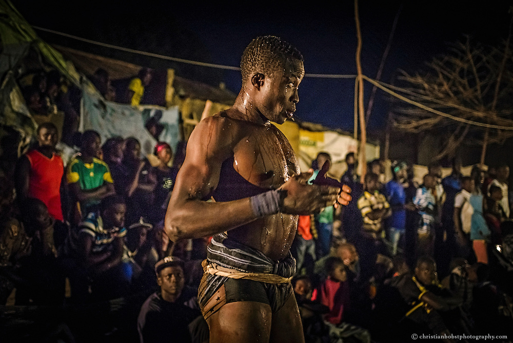April 1, 2015. At tornament on in Djilass, a small village in the disrict of Thiès, a wrestler gets ready for his fight after dancing himself into trance.