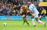 Nikica Jelavic (left) of Hull City is pulled down by Vincent Kompany of Manchester City who gets sent off during the Barclays Premier League match at the KC Stadium, Kingston upon Hull<br /> Picture by Richard Gould/Focus Images Ltd +44 7855 403186<br /> 15/03/2014