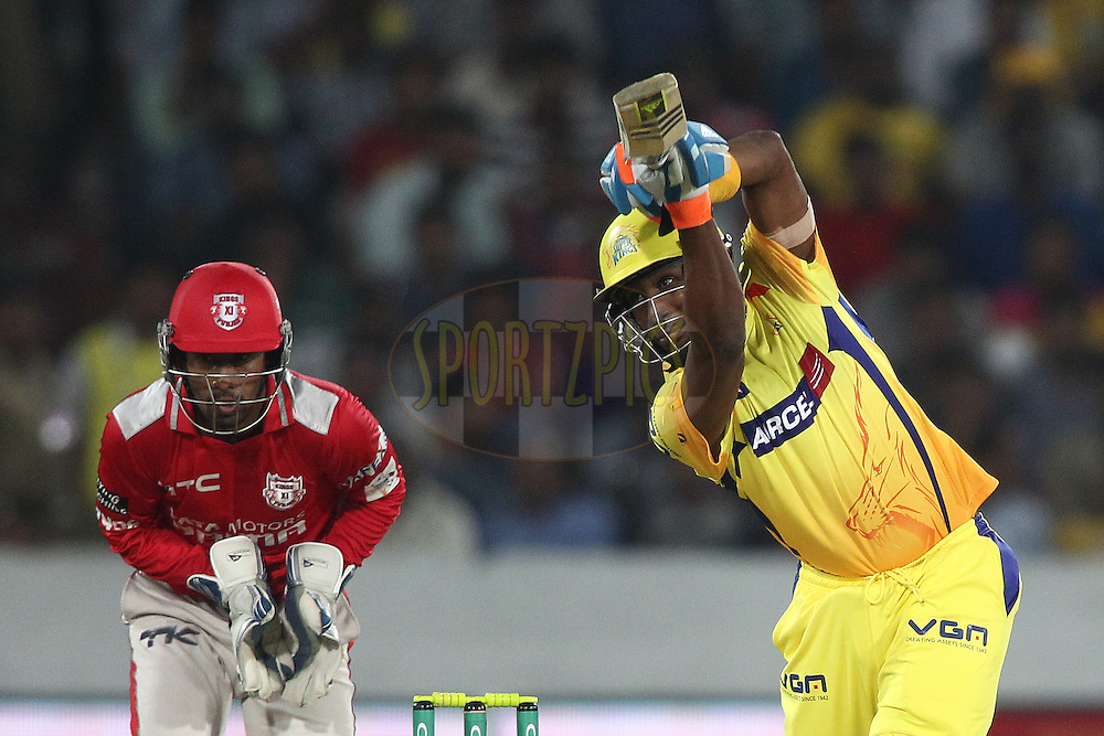 Dwayne Bravo of the Chennai Super Kings drives a delivery during the second semi final match of the Oppo Champions League Twenty20 between the Kings XI Punjab and the Chennai Superkings held at the Rajiv Gandhi Cricket Stadium, Hyderabad, India on the 2nd October 2014<br /> <br /> Photo by:  Shaun Roy / Sportzpics/ CLT20<br /> <br /> <br /> Image use is subject to the terms and conditions as laid out by the BCCI/ CLT20.  The terms and conditions can be downloaded here:<br /> <br /> http://sportzpics.photoshelter.com/gallery/CLT20-Image-Terms-and-Conditions-2014/G0000IfNJn535VPU/C0000QhhKadWcjYs