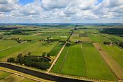 Nederland, Noord-Holland, Beemster, 14-06-2012;  De Beemster, 400 jaar 1612 - 2012. Overzicht met de Boven polder in de voorgrond, in NNO richting langs . In de voorgrond het Fort aan de Jisperweg en het Noordhollandsch kanaal (tevens Beemsterrringvaart). Middenbeemster rechts aan de horizon. De 17e eeuwse droogmakerij, met haar  beroemde geometrische verkaveling, maakt deel uit van het wereld erfgoed (Unesco werelderfgoedlijst)..The famous geometrical well-ordered polder Beemster, 17th century  reclaimed landscape, Unesco world heritage. Fortress, part of the Defensive Line of Amsterdam also world heritage..luchtfoto (toeslag), aerial photo (additional fee required);.copyright foto/photo Siebe Swart