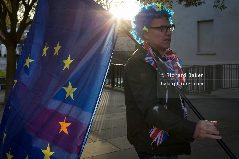 As Prime Minister Theresa May tours European capitals hoping to persuade foreign leaders to accept a new Brexit deal (following her cancellation of a Parliamentary vote), a pro-EU Remainer protests opposite the Houses of Parliament, on 11th December 2018, in London, England.