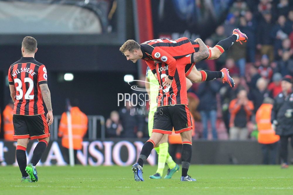 AFC Bournemouth defender (3) Steve  Cook lifts AFC Bournemouth's Ryan Fraser (24) in celebration after the Premier League match between Bournemouth and Liverpool at the Vitality Stadium, Bournemouth, England on 4 December 2016. Photo by Mark Davies.