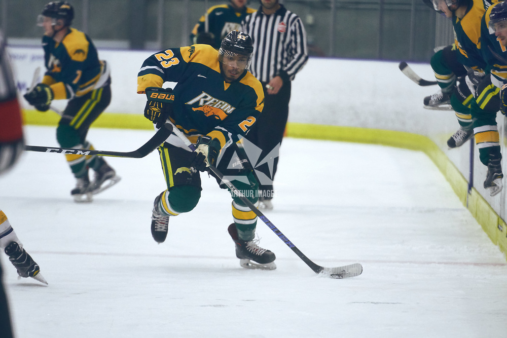 1st year forward, Arthur Miller (23) of the Regina Cougars during the Men's Hockey Home Game on Sat Oct 13 at Co-operators Center. Credit: Arthur Ward/Arthur Images