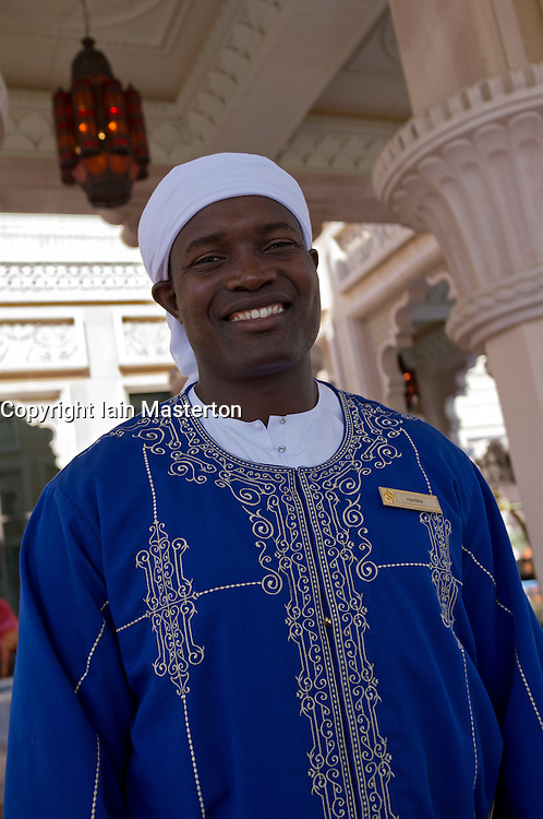 Portrait of doorman at entrance to luxury Al Qasr hotel in Madinat Jumeirah resort complex in Dubai in United Arab Emirates