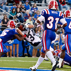 December 4, 2010; Ruston, LA, USA;  Nevada Wolf Pack running back Vai Taua (34) puts the ball across the goal line for a touchdown over Louisiana Tech Bulldogs cornerback Josh Victorian (15) during the second half at Joe Aillet Stadium.  Nevada defeated Louisiana Tech 35-17. Mandatory Credit: Derick E. Hingle