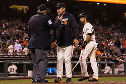 SAN FRANCISCO, CA - JULY 26: Bruce Bochy #15 of the San Francisco Giants talks with umpire Joe West #22 after he ejected Angel Pagan #16 for aruging a called third strike during the eighth inning against the Cincinnati Reds at AT&T Park on July 26, 2016 in San Francisco, California. The San Francisco Giants defeated the Cincinnati Reds 9-7.  (Photo by Jason O. Watson/Getty Images) *** Local Caption *** Bruce Bochy; Joe West; Angel Pagan