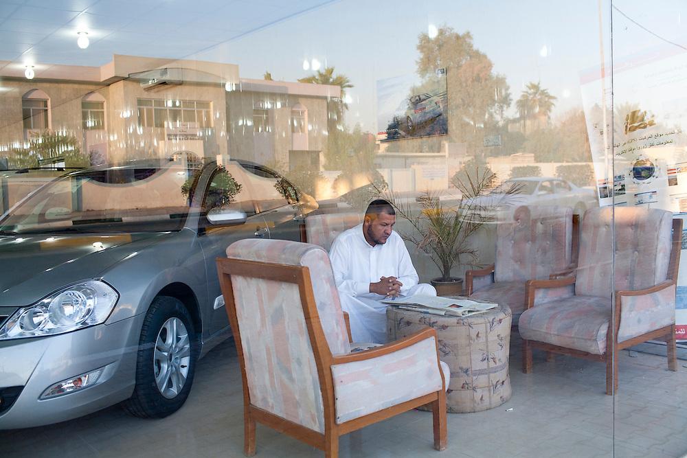 Car salesman Salam Septi inside the Hyundai dealership where he works on Friday, October 22, 2010 in Basrah, Iraq.