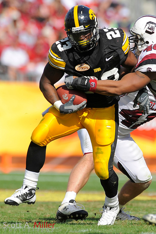 Jan 1, 2009; Tampa, FL, USA; Iowa Hawkeyes running back Shonn Greene (23) heads up field during Iowa's 31-10 win over the South Carolina Gamecocks in the Outback Bowl at the Raymond James Stadium. Greene was the game's MVP, scoring three touchdowns. ©2009 Scott A. Miller