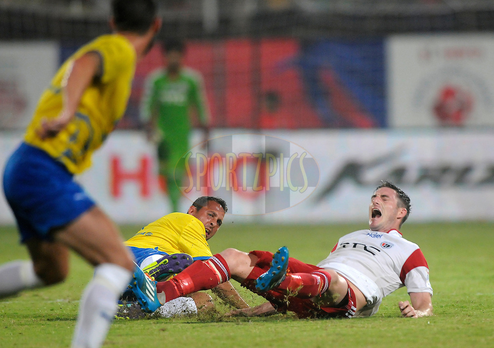 Michael Chopra of Kerala Blasters FC and James Keene of NorthEast United FC during match 49 of the Hero Indian Super League between Kerala Blasters FC and North East United FC held at the Jawaharlal Nehru Stadium, Kochi, India on the 30th November.<br /> <br /> Photo by:  Pal Pillai/ ISL/ SPORTZPICS