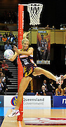 Laura Geitz reaches for the ball ~ Netball action from ANZ Championship Grand Final - Queensland Firebirds v Northern Mystics - played at the Brisbane Convention Centre on Sunday 22nd May 2011 ~ Photo : Steven Hight (AURA Images) / Photosport
