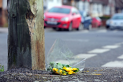 &copy; Licensed to London News Pictures.06/04/2018<br /> HITHER GREEN, UK.<br /> DAY 3 Hither Green Burglary Murder.<br /> A single bunch of yellow flowers with no card placed on Further Green Road at the junction with South Park Crescent, Hither Green. This is the road Burglar Henry Vincent collapsed in.<br /> Photo credit: Grant Falvey/LNP