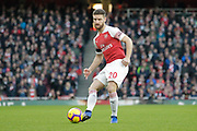 Arsenal defender Shkodran Mustafi (20) passes the ball during the Premier League match between Arsenal and Fulham at the Emirates Stadium, London, England on 1 January 2019.