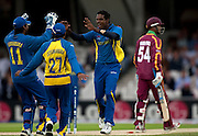 Angelo Mathews celebrates bowling Lendl Simmons during the ICC World Twenty20 Cup semi-final between Sri Lanka and West Indies at The Oval. Photo © Graham Morris (Tel: +44(0)20 8969 4192 Email: sales@cricketpix.com)
