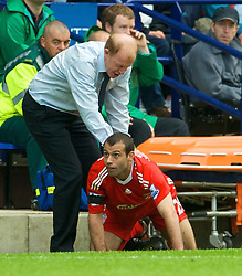 BOLTON, ENGLAND - Saturday, August 29, 2009: Liverpool's Javier Mascherano crashes into Bolton Wanderers' Bolton Wanderers manager Gary Megson during the Premiership match at the Reebok Stadium. (Photo by David Rawcliffe/Propaganda)