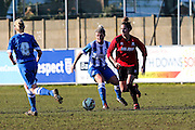 Brighton's Danielle Carlton and Hassocks' Katherine Chappell during the FA Women's Sussex Challenge Cup semi-final match between Brighton Ladies and Hassocks Ladies FC at Culver Road, Lancing, United Kingdom on 15 February 2015. Photo by Geoff Penn.