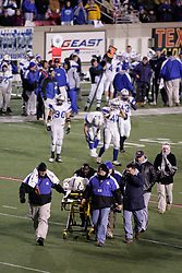 Trinity (Louisville) hosted Simon Kenton in the Class 6A KHSAA Commonwealth Gridiron Bowl on Saturday, Dec. 13, 2008, at Papa John's Cardinal Stadium in Louisville, Ky. Simon Kenton's Chad Lawrence is wheeled off the field on a stretcher after a helmet to helmet collision with two Trinity defenders. (photo by Jonathan Palmer)