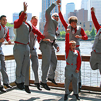 Pictures taken with the backdrop of the Mississippi river. The boys were having fun and decided to jump and celebrate.