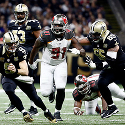 Dec 24, 2016; New Orleans, LA, USA; New Orleans Saints quarterback Drew Brees (9) runs from Tampa Bay Buccaneers defensive end Robert Ayers (91) during the second quarter of a game at the Mercedes-Benz Superdome. Mandatory Credit: Derick E. Hingle-USA TODAY Sports