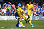 AFC Wimbledon midfielder Jake Reeves (8) tackling Bristol Rovers striker Ellis Harrison (9) during the EFL Sky Bet League 1 match between AFC Wimbledon and Bristol Rovers at the Cherry Red Records Stadium, Kingston, England on 8 April 2017. Photo by Matthew Redman.