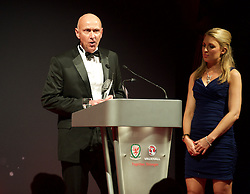CARDIFF, WALES - Monday, October 5, 2015: Wales' head of pubic affairs Ian Gwyn Hughes presents the Media Choice Award during the FAW Awards Dinner at Cardiff City Hall. (Pic by Ian Cook/Propaganda)