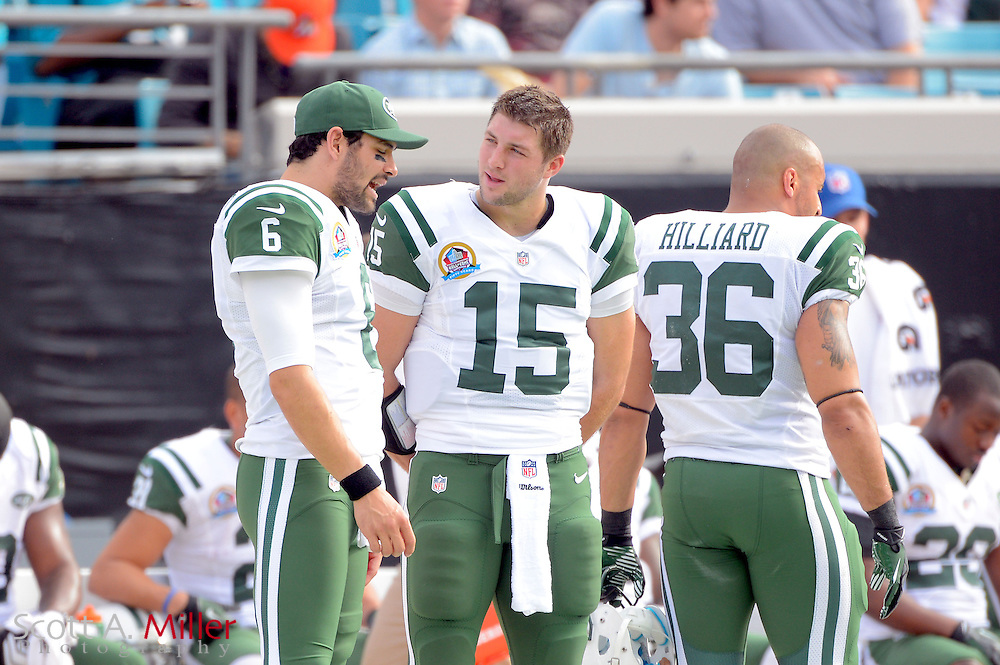 New York Jets quarterbacks Tim Tebow (15) and Mark Sanchez (6) with their helmet off on the sidelines during an NFL game against the Jacksonville Jaguars at EverBank Field on Dec 9, 2012 in Jacksonville, Florida. The Jets won 17-10...©2012 Scott A. Miller..