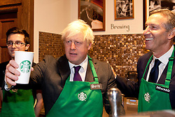 © under license to London News Pictures. 25/06/12..Mayor of London, Boris Johnson meets young apprentices with Starbucks chairman Howard Schultzat at the coffee house which is part of a commitment to hire a large number of apprentices across the capital. ..ALEX CHRISTOFIDES/LNP