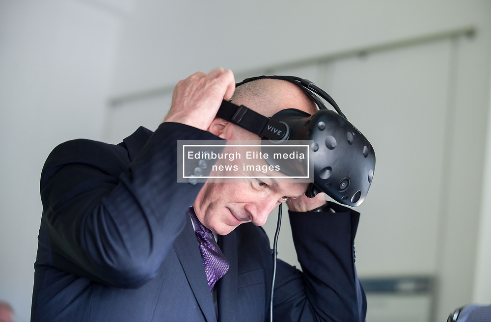 Pictured: Education Secretary John Swinney MSP tries out one of the new interactive 3D games.<br /> <br /> © Dave Johnston / EEm