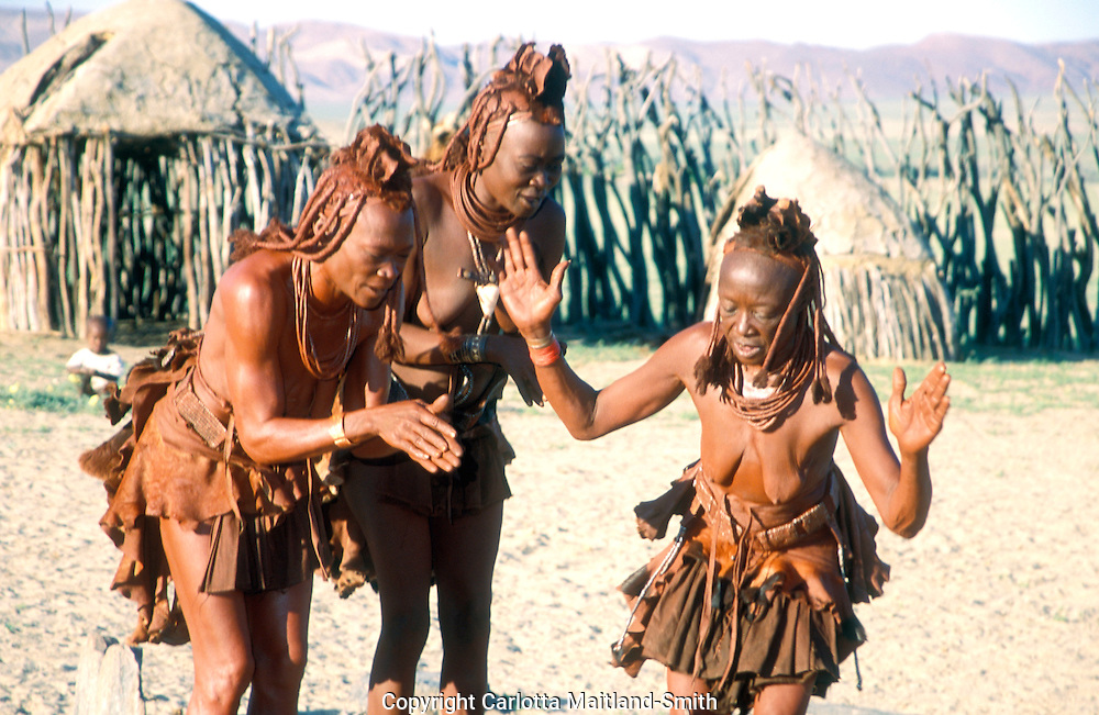 Namibia Kunene region Himba village woman Himba people fled from the Nama warriors to the remote north-west in the 19th century They are a subgroup of the Herero The Himba managed to maintain their traditional dress of multi-layered goat-leather miniskirts and ochre-and-mud-encrusted iron, leather and shell jewellery. They use a natural herbal perfume known as 'otjizumba' and smear their skin with a mixture of butter, ash and ochre. They wash once during their lifetime - the day after their wedding  The Himba avoid the modern world and continue a semi-nomadic lifestyle, raising sheep, goats and some cattle...