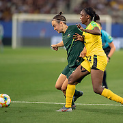 GRENOBLE, FRANCE June 18.  Caitlin Foord #9 of Australia defended by Sashana Campbell #12 of Jamaica during the Jamaica V Australia, Group C match at the FIFA Women's World Cup at Stade des Alpes on June 18th 2019 in Grenoble, France. (Photo by Tim Clayton/Corbis via Getty Images)