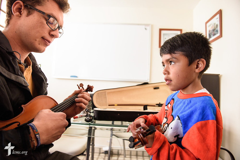 Tyler McMiller, LCMS missionary to Mexico, leads a violin lesson to a young student on Saturday, Feb. 13, 2016, in Mexico City, Mexico. LCMS Communications/Erik M. Lunsford