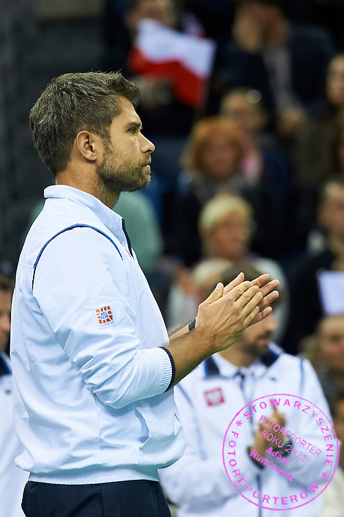 Trainer coach Tomasz Wiktorowski from Poland reacts after winning point during First Day of the Fed Cup / World Group 1st round tennis match between Poland and Russia at Tauron Krakow Arena on February 7, 2015 in Cracow, Poland.<br /> <br /> Poland, Cracow, February 7, 2015<br /> <br /> Picture also available in RAW (NEF) or TIFF format on special request.<br /> <br /> For editorial use only. Any commercial or promotional use requires permission.<br /> <br /> Adam Nurkiewicz declares that he has no rights to the image of people at the photographs of his authorship.<br /> <br /> Mandatory credit:<br /> Photo by &copy; Adam Nurkiewicz / Mediasport