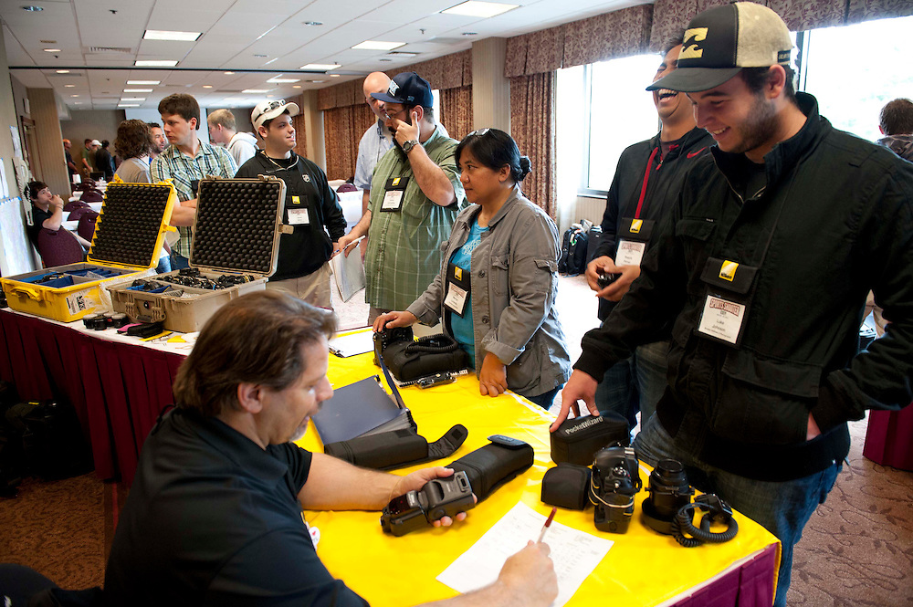 4/26/12 --- SPORTS SHOOTER ACADEMY --- Irvine, CA --- Nikon Professional Services Mike Corrado checks out loaner equipment to workshop participants. Photo by Rafael Delgado, Sports Shooter Academy Behind the Scenes with the cast and crew of Sports Shooter Academy.