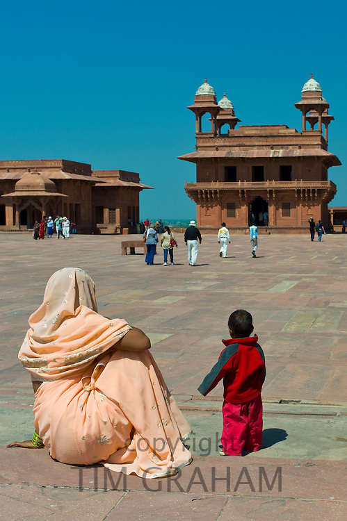 Tourists at Fatehpur Sikri 17th Century historic palace and city of Mughals, UNESCO World Heritage Site at Agra, Northern India