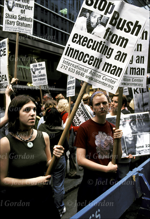 Anti-Death Penalty protestors with signs - Anti - Gov Bush  - NYC - Gov Bush about to execute an innocent man - NY Republican Party Headquarters, NYC - June 19, 2000. Gary Grahan ( Shaka Sankofa) an innocent African American on death row in Texas is scheduled to be executed on 6/22/00.